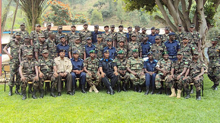 The graduates pose for a group photo after completing the training. (Photo by  A. Ngarambe)