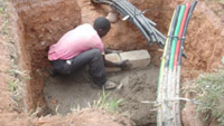 A Man lays Fibre Optic cables. EALA legislators will be touring such projects (File Photo)