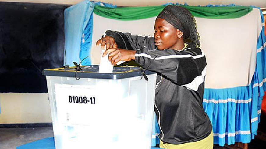 One of the voters casting her vote at Rugunga polling station. . (Photo T. Kisambira)