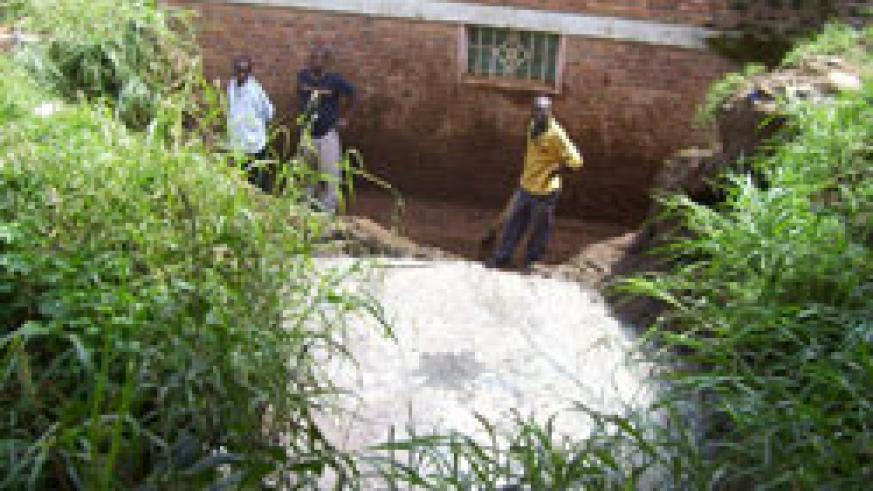 The owner of the house next to the abbatoir  and attempt to stop the sewage flow. (Photo by A.Gahene)