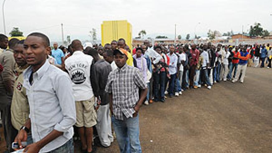 Permit applicants queue up to register. Police has introduced online registration (File Photo)