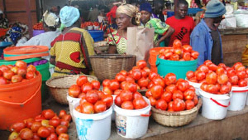 Market vendors in Kimironko market, Minister Monique Nsanzabaganwa plots measures to control hoarding. (File photo)
