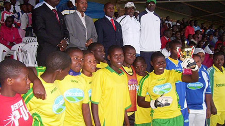 APAPEB High school girls welcome a trophy awarded to them after defeating teachers in a football match on Sunday. (Photo:  A. Gahene)