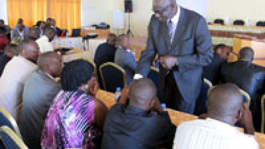 High Court president Johnston Busingye interacting with some of the judges in the meeting yesterday (Photo J Mbanda)