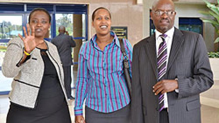 Outgoing RRA boss Mary Baine with Finance PS Kampeta Sayinzoga and new RRA chief Ben Kagarama after the handover (courtsey photo)