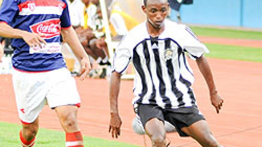 APR's Jean Claude Iranzi tries to dribble past a Club Africain player during the first leg. The teams meet again this afternoon in the second leg. (File photo)