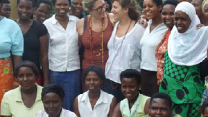 Linda Trau (L) shares a light moment with daughter Jenny during a group photo with some of the women (Courtesy photo)