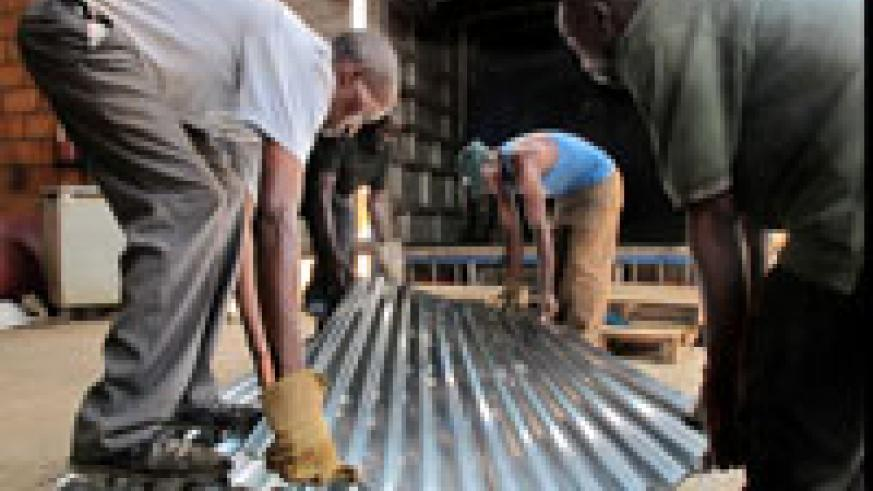 Iron sheets being loaded on the truck to be delivered to desginated districts yesterday (Photo T.Kisambira)