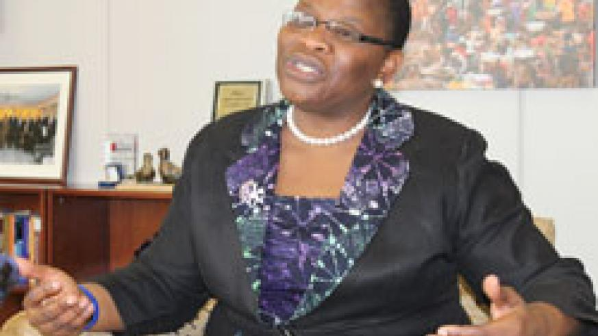 Ms. Ezekwesili speaking to journalists in Washington office, the picture of African market teeming with female traders in the backdrop. (Photo Herbert Boh, World Bank.)