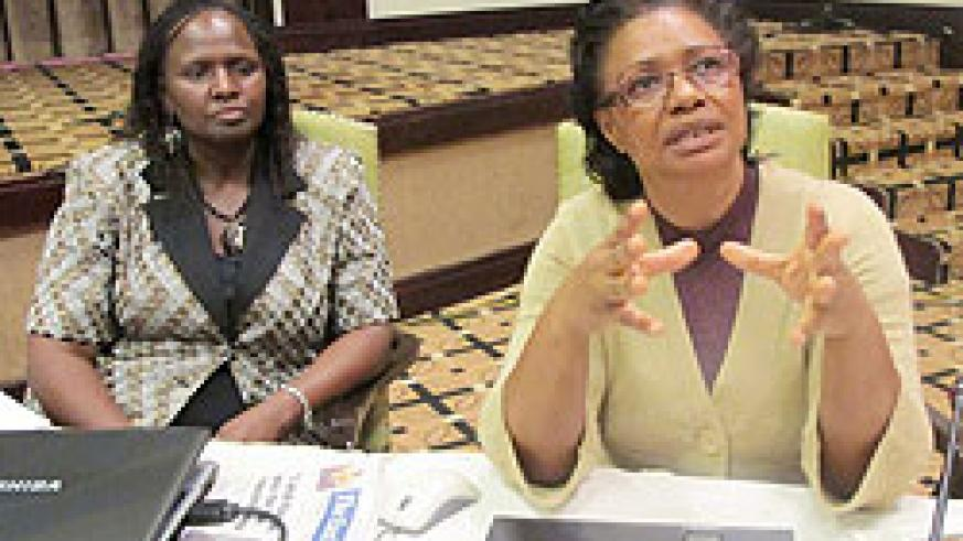 Helen Kenani (R) a trade Expert with COMESA and Vonesai Hove of Trademark Southern Africa speaking to the Press. (Photo J Mbanda)