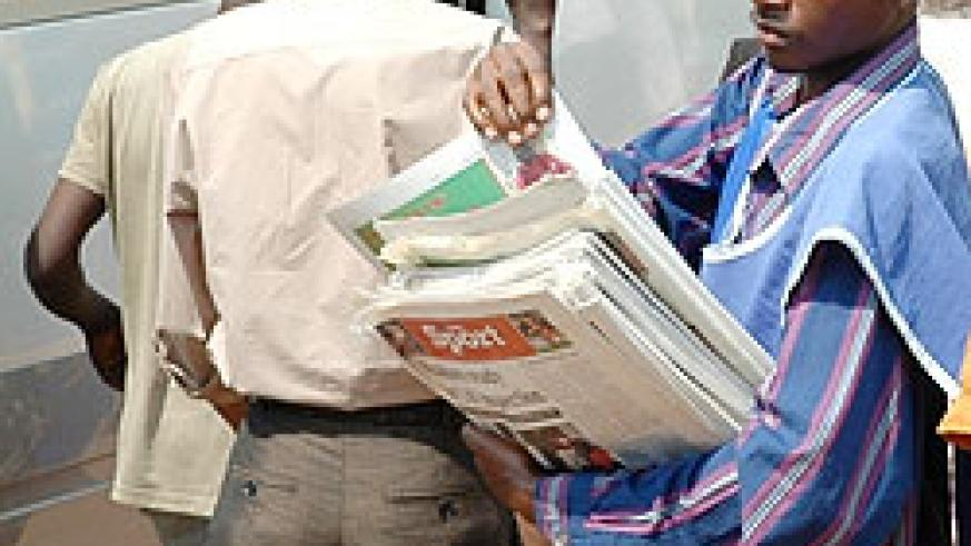 A Newspaper vendor in Kigali City. MHC has released a new list of accredited media houses (File Photo)