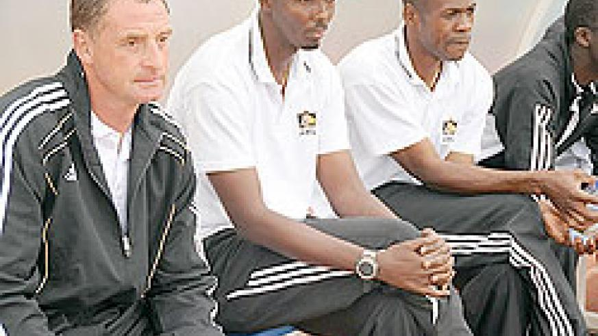 APR coach Ernest Brandts and his assistants during a previous Primus league game. The Dutchman still has a 100% record after winning all 10 league matches.  (File photo)