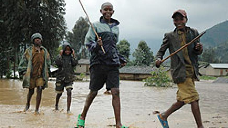 Children play in a flooded area in Western Province; authorities in the province have been advised to include disaster management in its 20112012 budget (File photo)