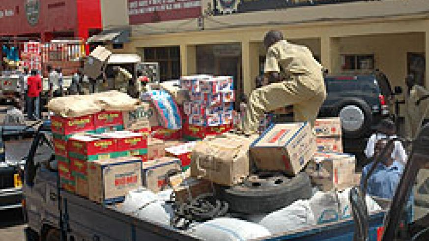 A man unloads commodities from a truck in Kigali city, KCC is currently processing documents of tax defaulters in the city for court proceeding.(File photo)