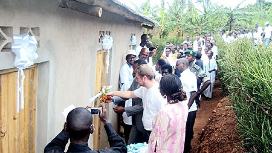 The head of AVSI-Rwanda Calvin Guido, inaugurating one of the houses constructed for vulnerable families in Muhura sector (Photo. D. Ngabonziza)