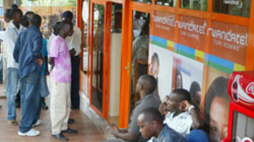 Customers line up for Rwandatel services at one of the operators shops in Kigali (Fle photo)