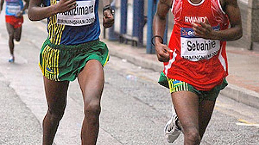 Gervais Hakizimana (L) and Eric Sebahire (L) taking part in a road race in France last year. The two are on the team for the World Cross Country Championship in Spain. (File photo)