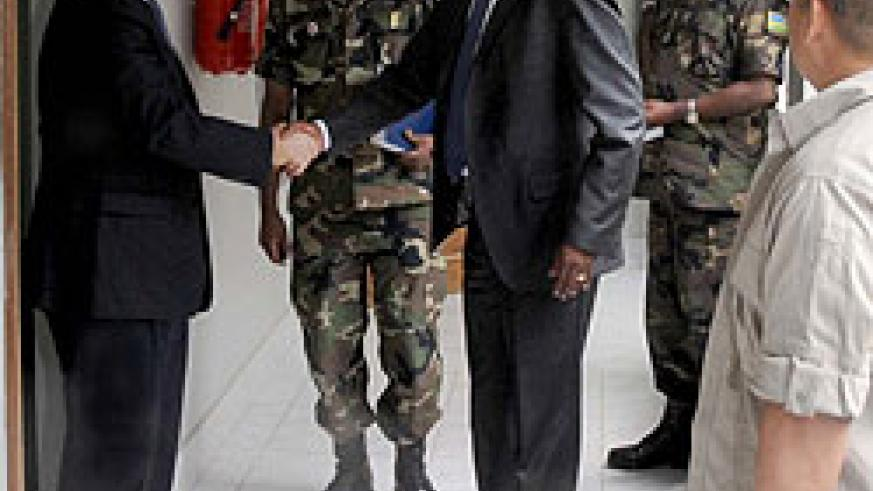 Gen James Kabarebe receives MONUSCO boss Roger Meece at the former's office yesterday (Photo T Kisambira)