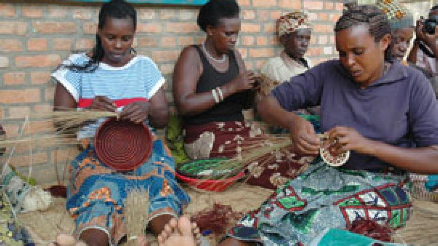 Women weaving. The new law recquires them to register their trade. (File photo)