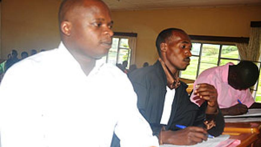 Jean Ndimubahire, his attorney Felicien Bimenyimana and co-accused Jean Pierre Nsabimana, in court yesterday (photo S Nkurunziza)