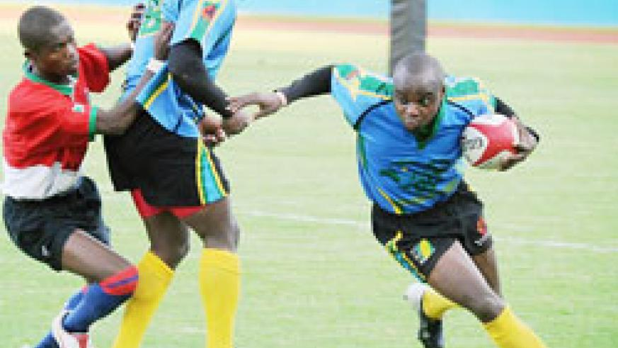 Silverbacks captain Vincent Kamali (R) during last year's CAR 15s tournament. He is expected to lead from the front. (File photo)
