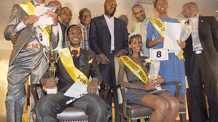 The finalists pose for a photo with the officials.  (Photo / T. Kisambira)