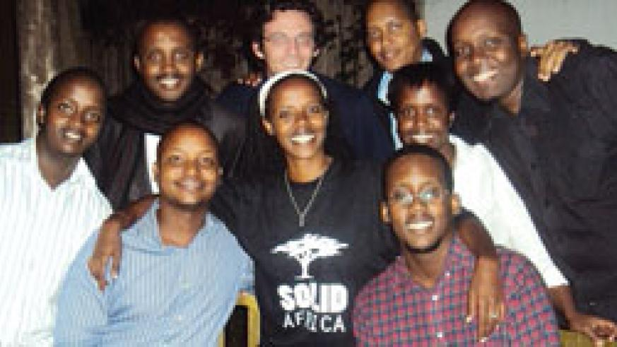 Isabelle Kamariza (C) in the Solid Africa T-shirt is the founder Member.(Courtesy Photo)