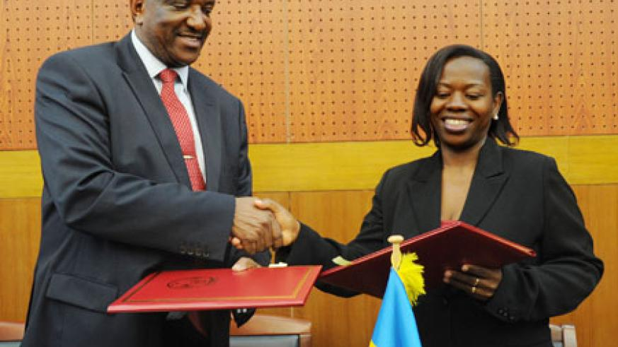 Minister Monique Nsanzabaganwa (R), and Kenyan Co-operatives Minister, Joseph Nyaga, after signing the MoU, yesterday (Photo T.Kisambira)
