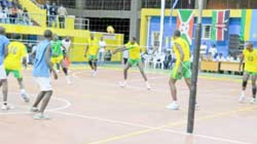 Rwanda's Flavien Ndamukunda setting for his teammates to spike during yesterday's Zone five qualifier against Burundi. Rwanda won the tie 3-0. (Photo: T. Kisambira)