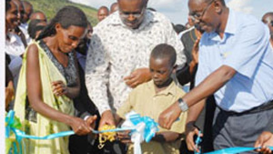 A young Boy joins Prime Minister Bernard Makuza and other officials at the Launch of Kiliba Dam in Gatsibo District on Wednesday. (Photo J Mbanda)