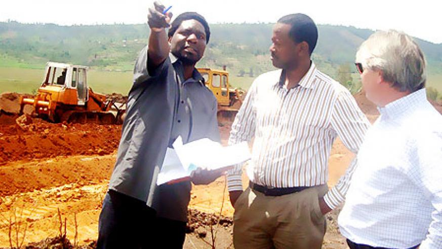 BRD Boss Jack Kayonga, (C) during a visit at the site for the Kinazi Cassava Factory. (Photo D Sabiiti)