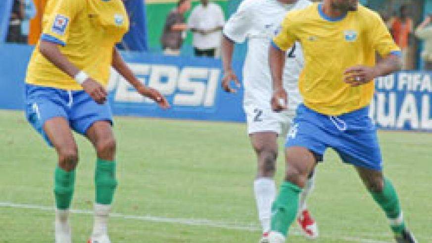 Amavubi Stars midfielder Jean Baptiste Mugiraneza (left), seen in this file photo playing against  Eq. Guinea in 2009, has been drafted to beef up the Olympics team for the Zambia clash. (File photo)