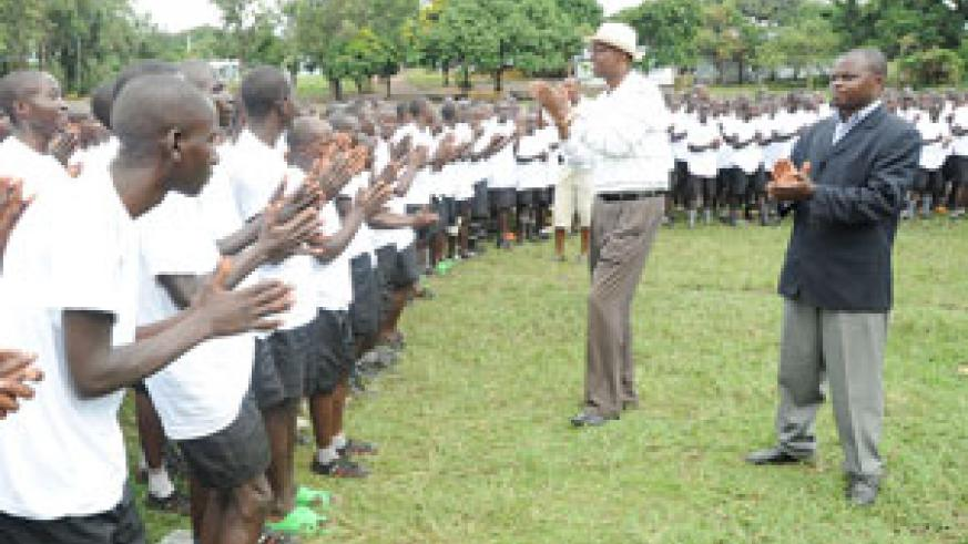 Youth Minister Protais Mitali (with hat) joins the Iwawa trainees in a dance recently. (File Photo))