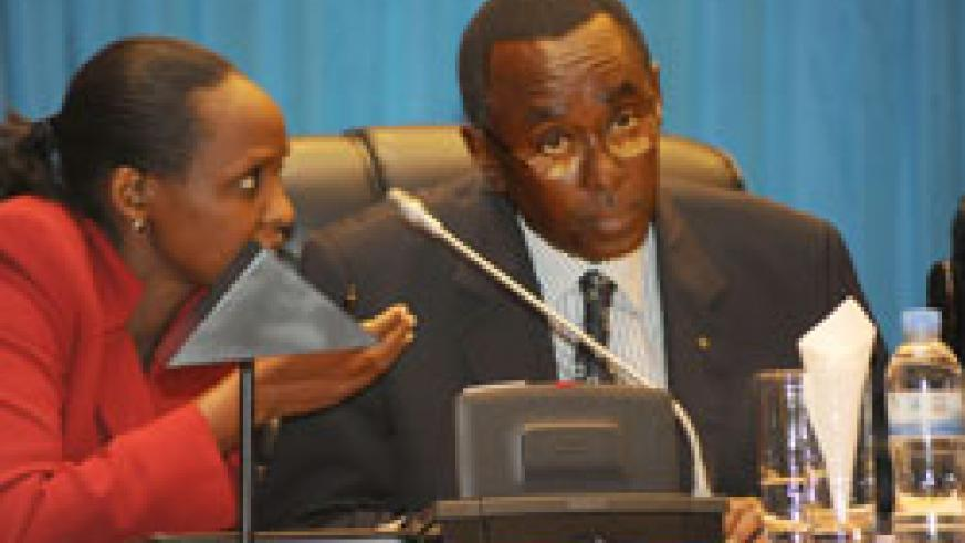 Premier Bernard Makuza (R) consults Agriculture Minister Dr Agnes Kalibata, in Parliament, yesterday (Photo T Kisambira)