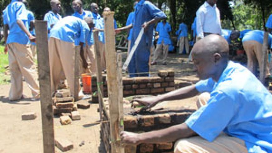Former street children at the Youth Rehabilitation and Vocational Skills Development Centre, Iwawa Island, learning how to build (Photo D. Umutesi)