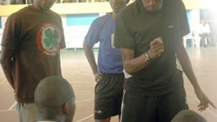 BACK IN THE DAYS: Jean Luc Ndayikengurukiye passing on tips to APR's men volleyball team.