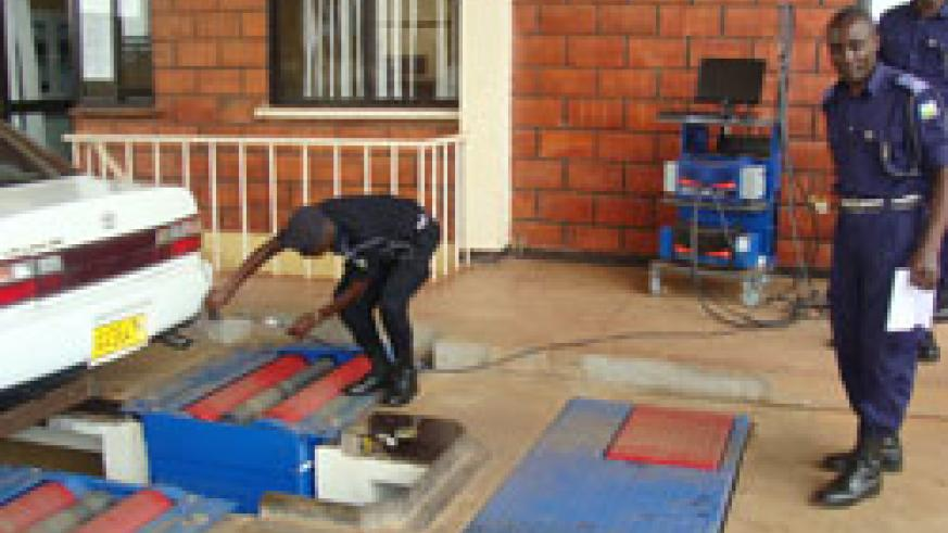 A Police officer tests one of the vehicles at the inspection centre (Courtesy Photo)