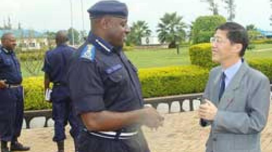 IGP Emmanuel Gasana (R) with the Chinese envoy, Shu Zhan, after their meeting yesterday (Courtsey Photo)