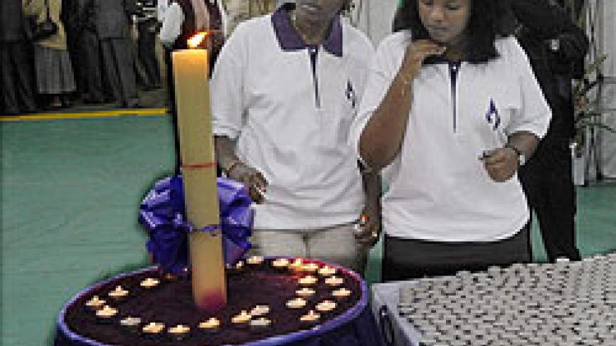 Candles being lit at the Genocide exhibition early this week.
