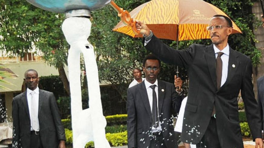 President Kagame lights the flame at Gisozi GenocideMemorial site yesterday. (Photo J Mbanda)