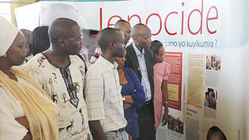 People tour a Genocide exhibition at Petit Stadium during this year's commemoration week. (Photo J Mbanda)