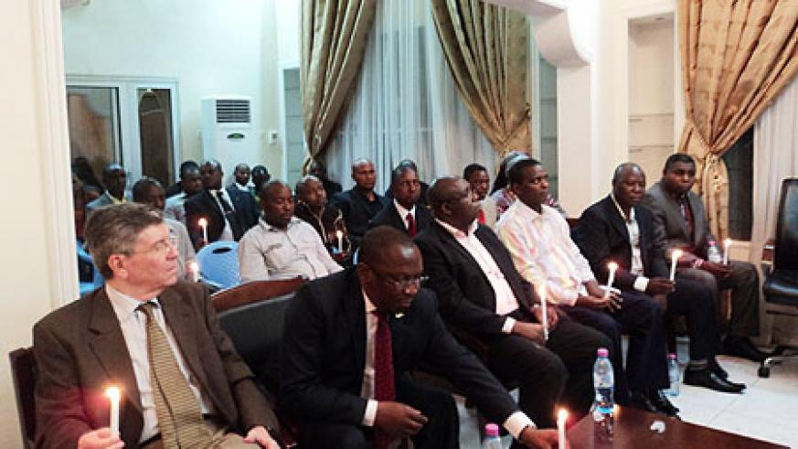 Rwandan Ambassador to DRC Amandin Rugira (Placing a candle on table) together with other envoys during the 17th commemoration of the 1994 Genocide against the Tutsi