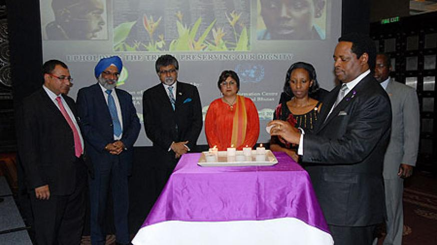 Williams Nkurunziza (R), Gurjit Singh, a UN Official and African Diplomats during a candle-lighting event in India (Courtsey Photo)