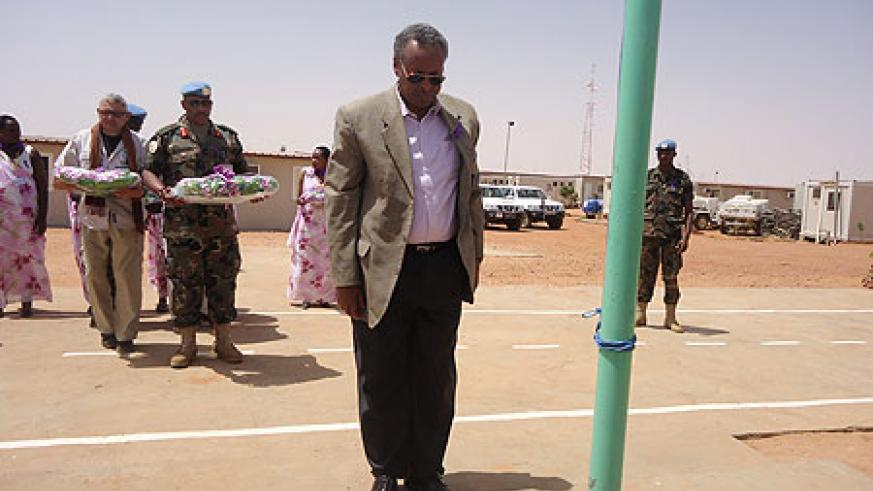 UNAMID's Deputy Joint Special Representative, Mohamed Yonis. honours Genocide victims. In teh background is Gen. Patrick Nyanvumba holding a wreath. (Courtesy Photo)
