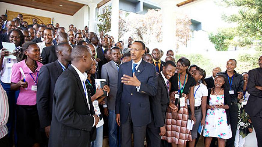 President Kagame chats with youth from the region after a meeting at Village Urugwiro, yesterday. (Photo Village Urugwiro)