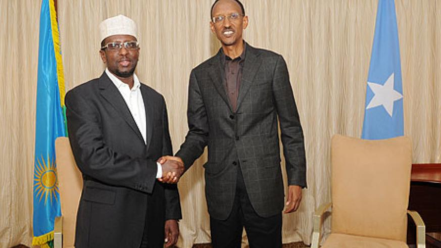 President Kagame with the President of Somalia, Sheik Sharif Ahmed, yesterday in Kigali. (Photo Village Urugwiro)
