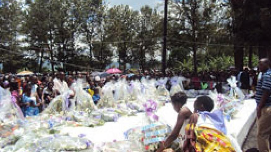 Mourners laying wreaths at mass graves  at Kiziguro genocide memorial site. (Photo.D Ngabonziza).