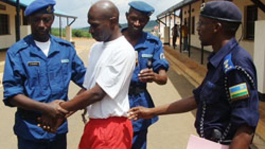 The suspect was, yesterday, handed over to Burundian Police officials. (Courtesy photo).