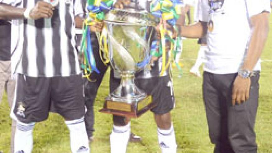 Former APR captain Patrick Mafisango showing off the 2010 Cecafa Kagame Cup moments after APR's 2-1 win over St. George in the final. (File Photo)