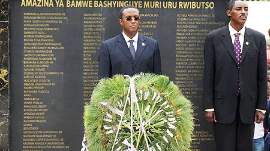 Senate president Dr Vincent Biruta (L) and CNLG Executive Secretary, Jean de Dieu Mucyo, after laying a wreath in memory of slain politicians yesterday. (Photo / T. Kisambira)